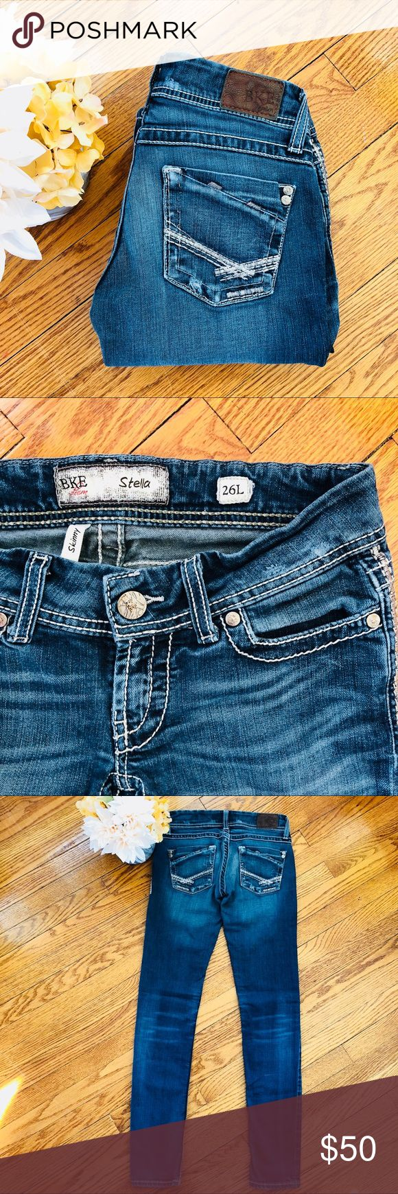 """BKE Stella 26x33.5 Skinny Long BKE Stella Skinny Jeans Medium Wash  Contrast Silver Stitching  Thick Stitching on back pockets  Waist 15"""" Front Rise 7"""" Back Rise 10"""" Some of the darker stitching on back pocket has come loose, but has no structural effect.  Great condition BKE Jeans Skinny"""