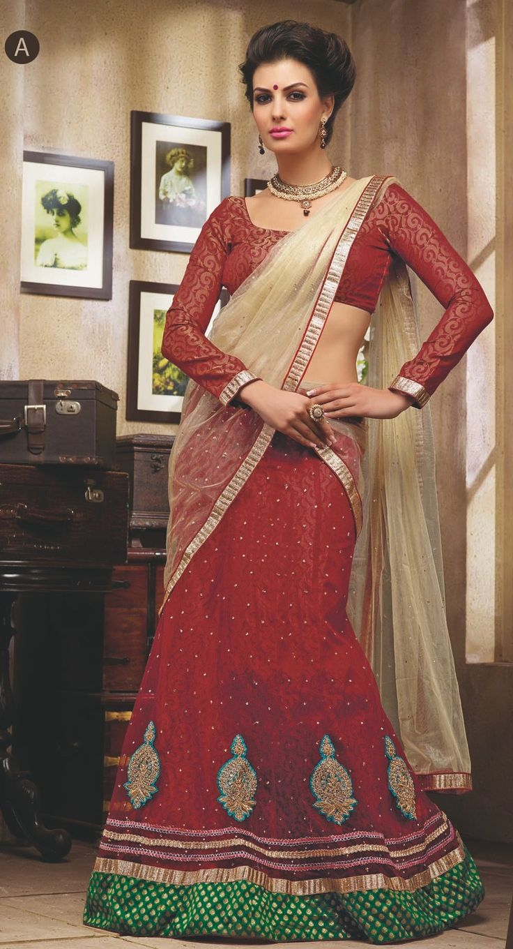 Add Grace And Charm To Your Look In This Enticing Red Net Lehnga Choli. The Enticing Lace Work,Patch Work,Resham Work,Stone Work. A Intensive Attribute Of This Dress.