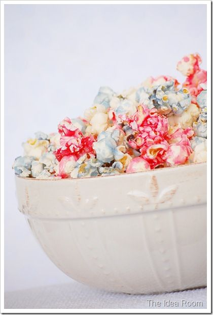 Candied Popcorn    1 cup sugar    1/2 tsp. salt    1/4 cup water    1 tsp. vanilla    6 cup popcorn (popped)    Few drops of food coloring (optional)    Boil sugar, salt and water to 235 degrees (sof    Add vanilla.  Pour over popped popcorn and stir until glaze sugars.