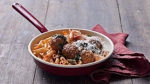 Veal & pork polpetti with tomto & oregano sugo. Karen Martini ITALIAN MEATBALL recipes for Epicure and Good Living. Photographed by Marina Oliphant. Styling by Caroline Velik. Props this image stylist's own. Photographed September 4, 2012. The Age Newspaper and The SMH.