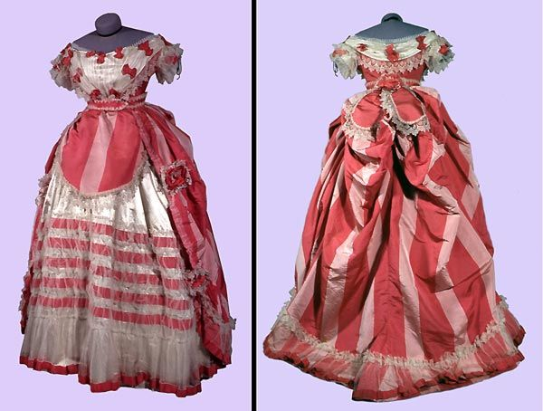 Circa 1865 elaborate Silk, Tulle, and Satin evening dress in stripes of deep rose and pale pink silk over a white satin petticoat and white tulle, France.