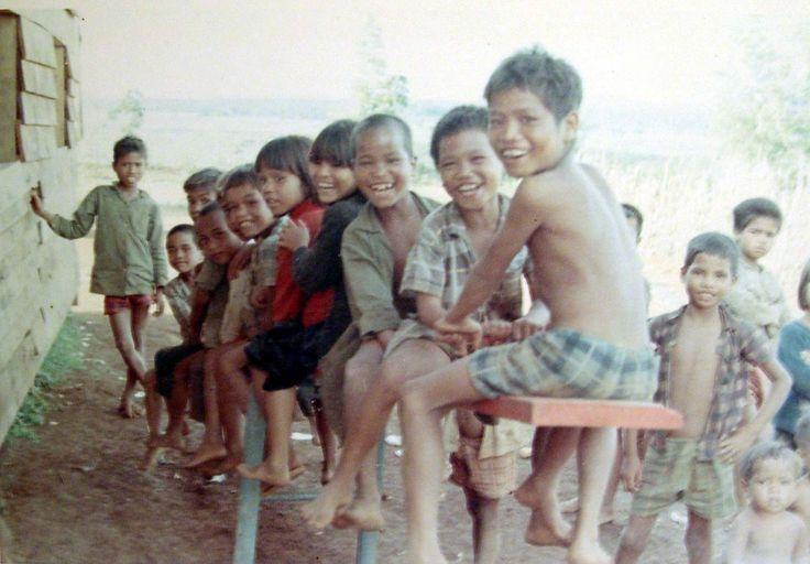Montagnard children piled on a seesaw.