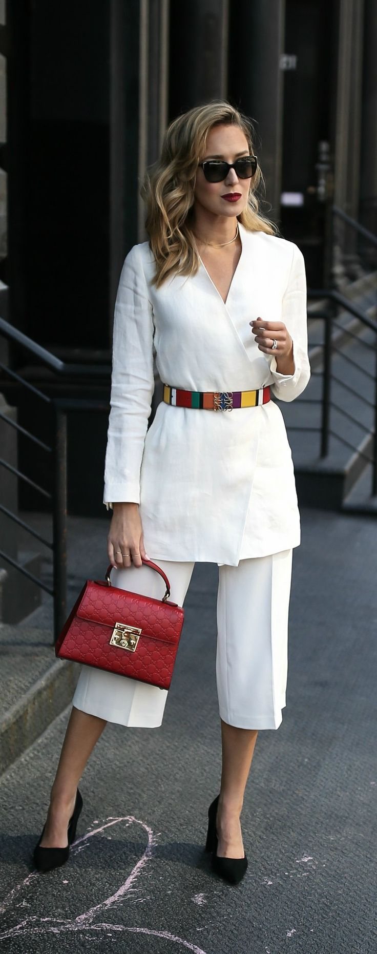 Top 10 Spring Trends to Know // Trend #3: 80s Redux // click the image for all the details! // ivory wrap linen blazer, ivory culottes, pant suit, red gucci bag, bold stripe colorful waist belt, pops of color, bold red lip, black block heel pointed toe pumps {theory, loewe, gucci, reiss, prada, work wear}