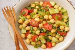 Grape tomatoes and fresh cilantro add colour to this flavourful Chickpea Salad. It's a cinch to make and a tasty way to get more chickpeas on the menu!