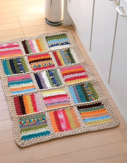 Patchwork Rug... might have to search for 'rug' to find it on the site.  It is a free pattern on ravelry though.  So purty!    DIY Free Pattern for Crocheted Patchwork RugfromRavelry here.If you crochet or knit I'd suggest signing up for this site - it's free and has many unbelievable free patterns.The PDF pattern for the rug is here.  Maybe use up all the scrap yarn