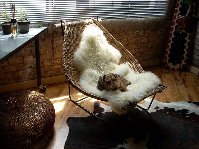Rattan furniture with sheep- and cowskin.
