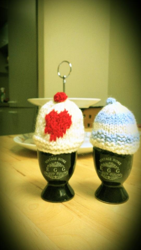 Home made knitted egg cosys to keep your eggs warm. Visit http://www.facebook.com/KittyAndTiz to find out how to buy