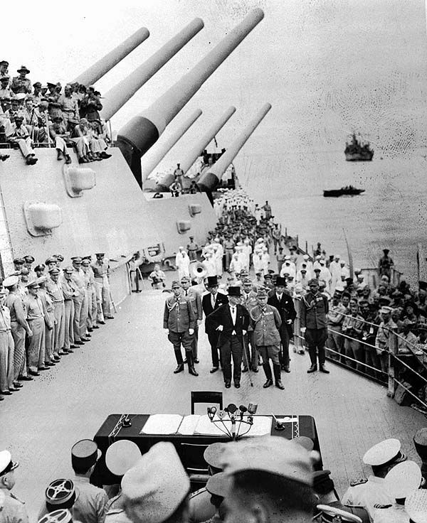 TOKYO — Foreign Minister Mamoru Shigemitsu, center in top hat, leads the Japanese delegation aboard the Missouri in Tokyo Bay for the signing ceremony for Japan's surrender in World War II.