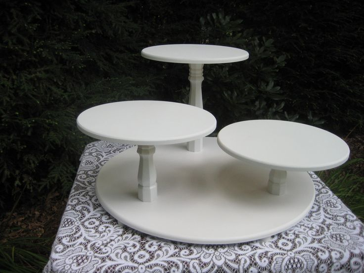 Ah, ha...this is a wedding cupcake stand but it could be a pie stand instead.  Like this in black better but this is lovely.  Must think if we can DIY this....