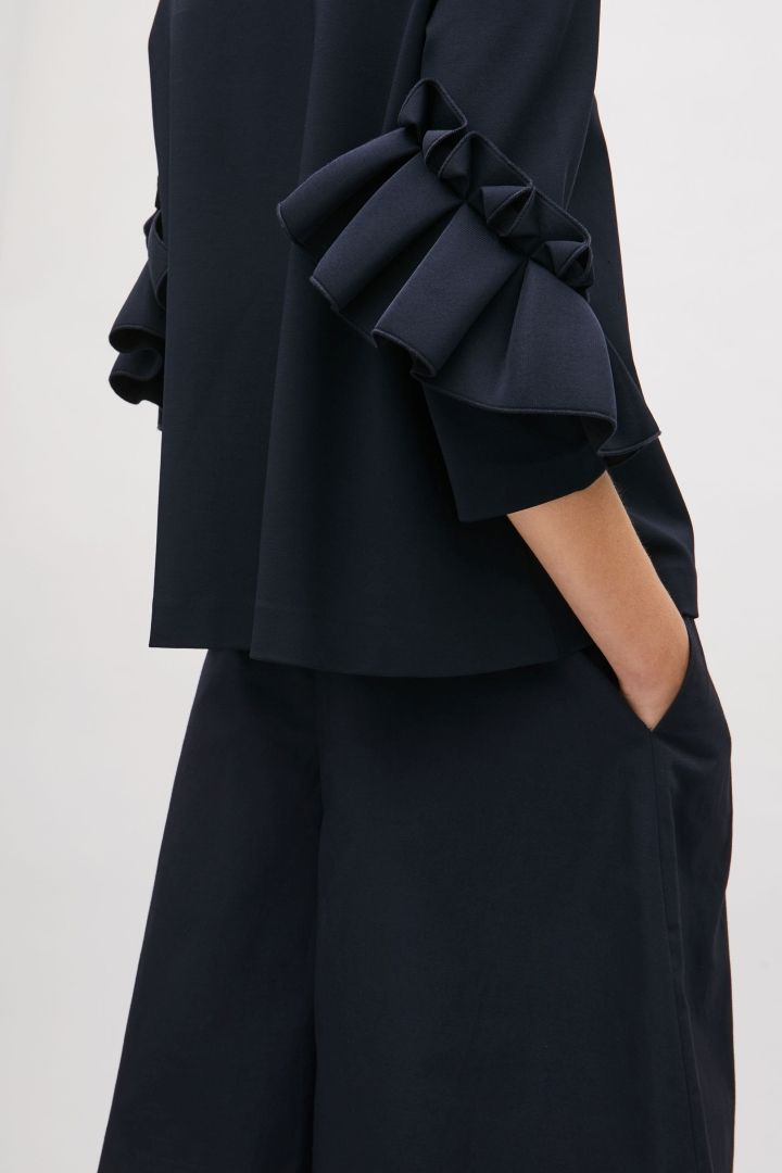 COS image 2 of Top with frill detailed sleeves in Navy