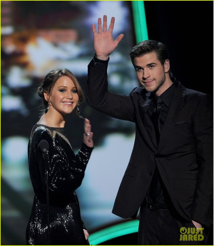 Jennifer Lawrence and Liam Hemsworth on stage at the 2013 People's Choice Awards on 01/09/12. The Hunger Games, which was nominated in 7 categories, walked away with all but one of those awards last night. They did take home honors in the following categories: Favorite Movie, Favorite Movie Actress, Favorite Action Movie, Favorite Face of Heroism – Jennifer Lawrence, Favorite Movie Franchise, and Favorite On-Screen Chemistry – Jennifer Lawrence, Josh Hutcherson, Liam Hemsworth.
