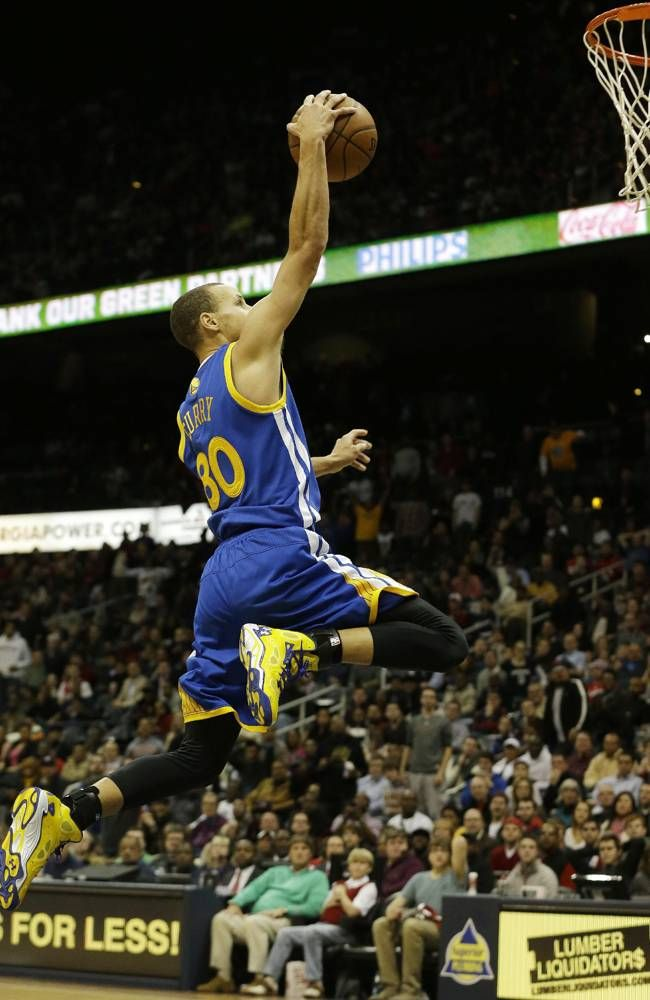 Golden State Warriors point guard Stephen Curry (30) scores against the Atlanta Hawks in the second half