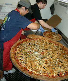 Giant pizzas in the making at Big Lou's... yup going to san antonio just for this... :)