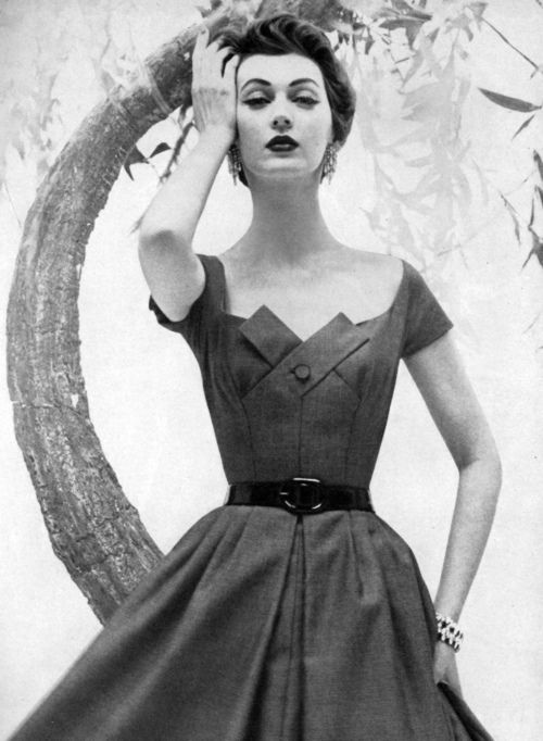 Dovima wearing a dress by Mollie Parnis, 1954.