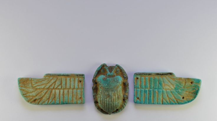 Egyptian winged scarab, Late period, 664-30 B.C. Egyptian winged scarab, Egyptian turquoise blue faience winged scarab with two separately made wings, the undersides are flat and the edges of the wings and scarab are pierced for stitching onto the mummy wrappings, yhe wings have detailed feathers and the scarab is decorated with stone and a striated wing case and articulated head and legs, which are outside the body, 18.5 cm long. Private collection