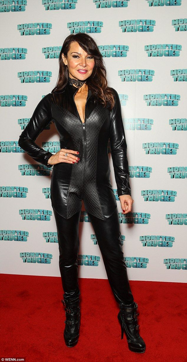 Catwoman: Lizzie Cundy, 48, squeezed into a skintight leather catsuit for a Monster Trucks screening at Vue Cinema in London's Westfield shopping centre, on Sunday