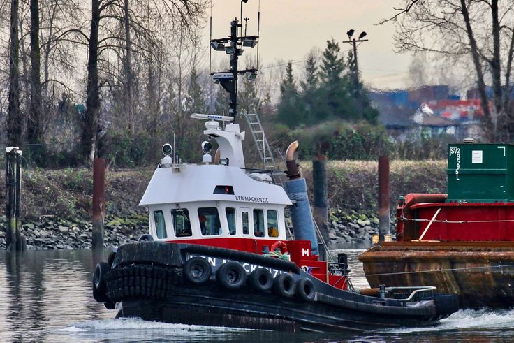 """Harken Towing's tugboat """"Ken Mackenzie"""" tows a barge in the North Arm of the Fraser River. Click image to enlarge."""