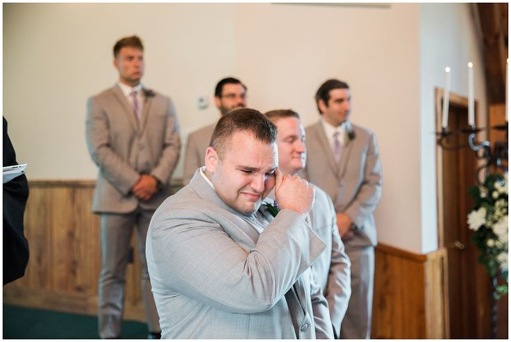 groom crying seeing his bride walking down the aisle for wedding ceremony