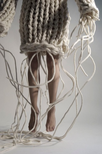 Chunky knitting - the trailing yarn threads that are left purposely hanging from this piece makes me think that its still on going - never finished - its quite supernatural