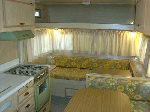 1971, this looks so much like my parents travel trailer but it was in browns and stripes. the lay-out is very similar. Stove was the copper color.