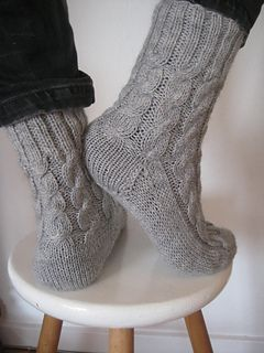 Free pattern on Ravelry - These socks are rustic, warm, thick socks. They do not have a close fit, but are excellent to wear as a second layer in winter, as a second layer over your normal cotton socks in your boots, when it gets really cold, or indoors as warm, cozy socks. This pattern is worked from the cuff down. The socks have a square heel and a standard, classic toe.
