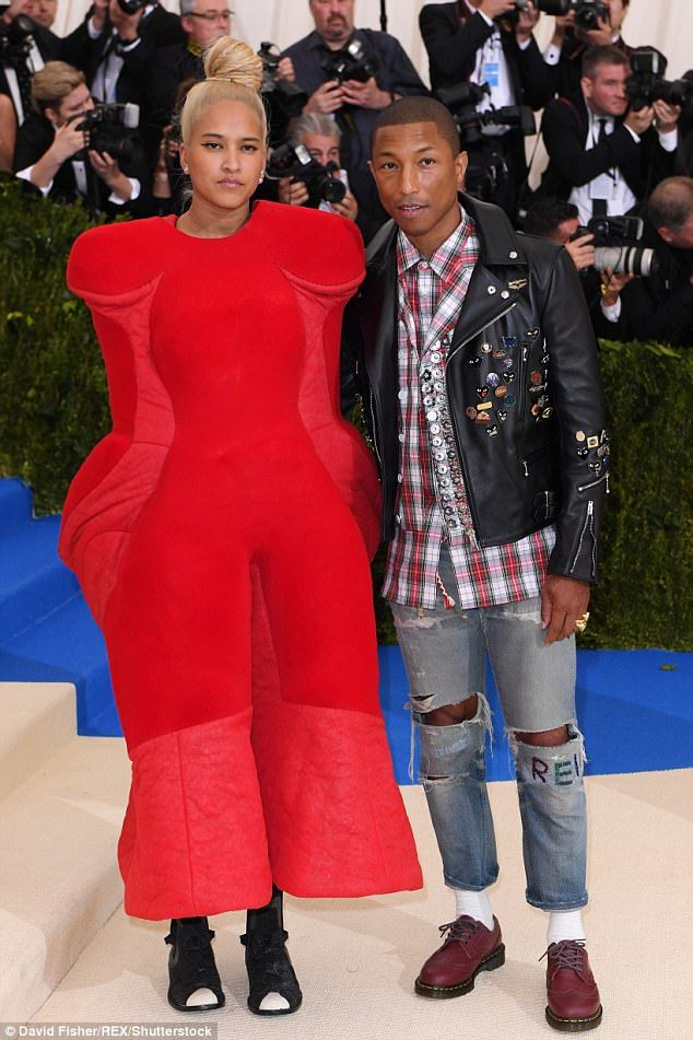 The risk of fashion: Pharrell's wife Helen Lasichanh won points among many fashion bloggers but Twitter had its own response to her choice of attire at the Met Gala on Monday in New York City