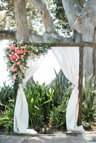Rustic 2 Post Wooden Arch with Asymmetrical Florals & Greens