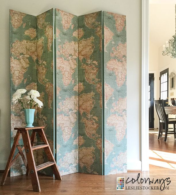 a beautiful folding screen created with the vintage world map fabric from the annie sloan fabric