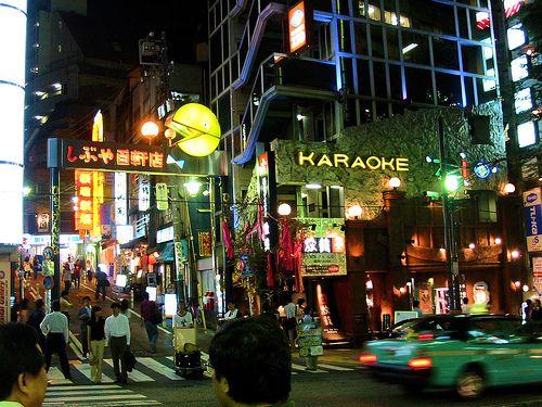 """Sing Karaoke in Tokyo  My first time singing kareoke was in Tokyo and I sang, """"The Sukiyaki Song,"""" in Japanese."""