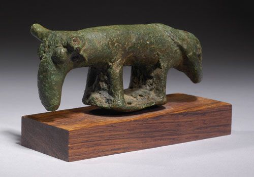 SARDINIAN BRONZE OX  With large elongated head and cylindrical body on small base. Rare.  Prehistoric Nuraghian Period, Ca. 8th Century BC  ...