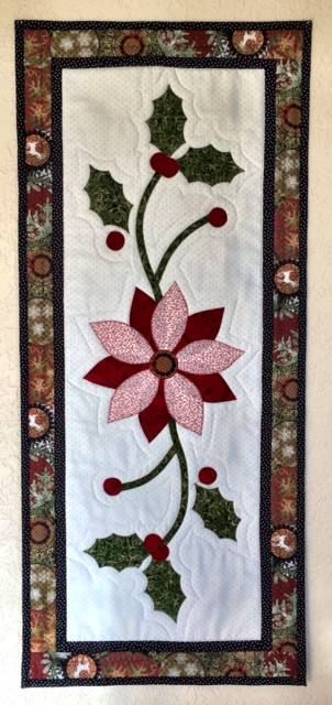 """Nancy Anders' version of the """"Set for the Season"""" table runner which appears in American Patchwork & Quilting's Christmas issue. She downloaded this free pattern and made a lovely Christmas gift. Thanks for sharing Nancy!"""