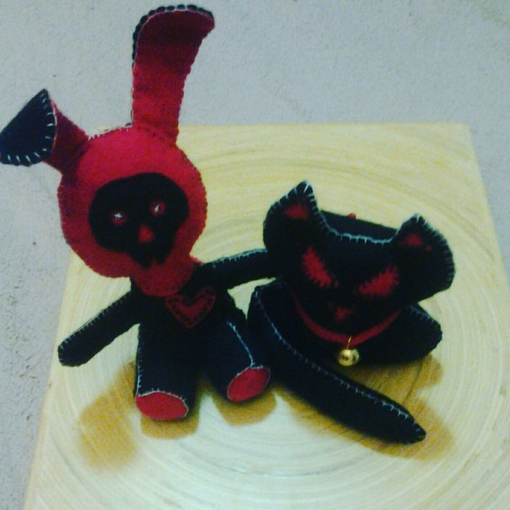Hand-stitched felt soft toys - Evil Dead Bunny and Demonic Kitty.
