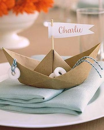 Kinda like the origami idea, not necessarily a boat but something. Name could be printed on clear labels and attached.