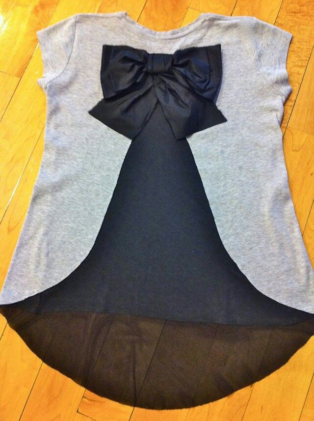 Quick Tip: If your shirt is too small but you really love the shirt, redesign by cutting out a pattern in the middle and sewing in new fabric. This designer added a bow for finishing touches-Sweet Tee Parlor