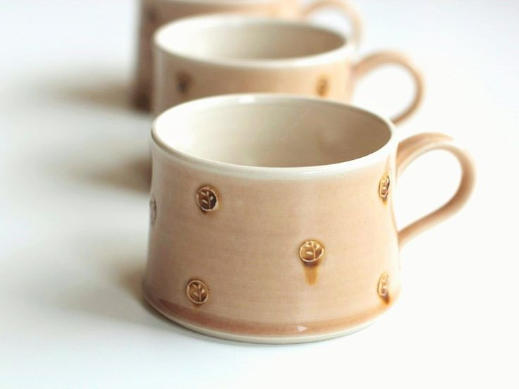 Thrown cups, stoneware clay.