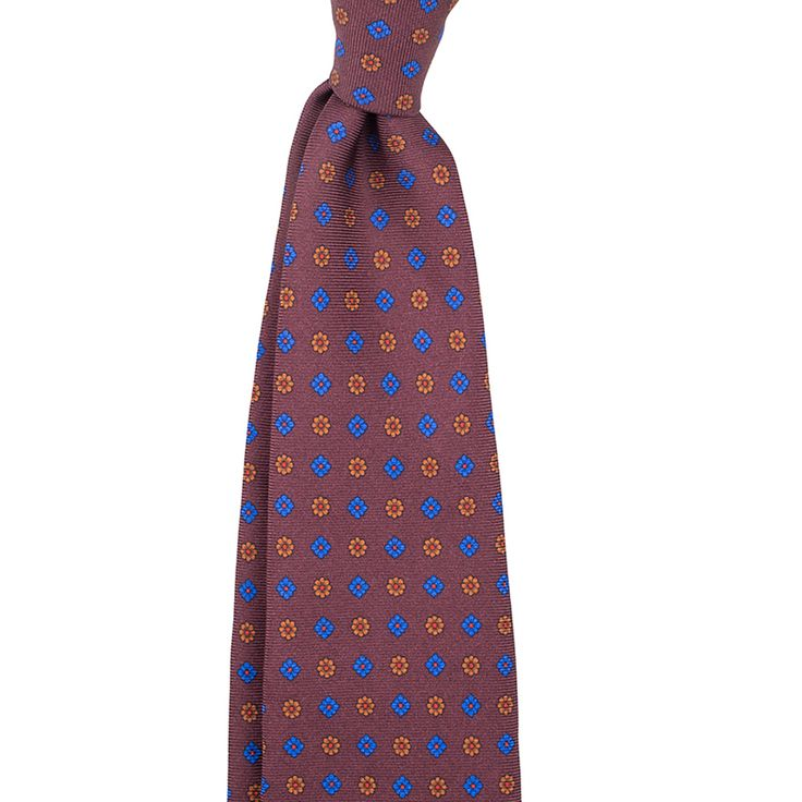 A tie crafted from a twill silk fabric with an elegant small pattern design. Features handrolled edges for a light and airy feel. Six fold construction adds weight and drape. Handmade in Como, Italy, for Berg&Berg.