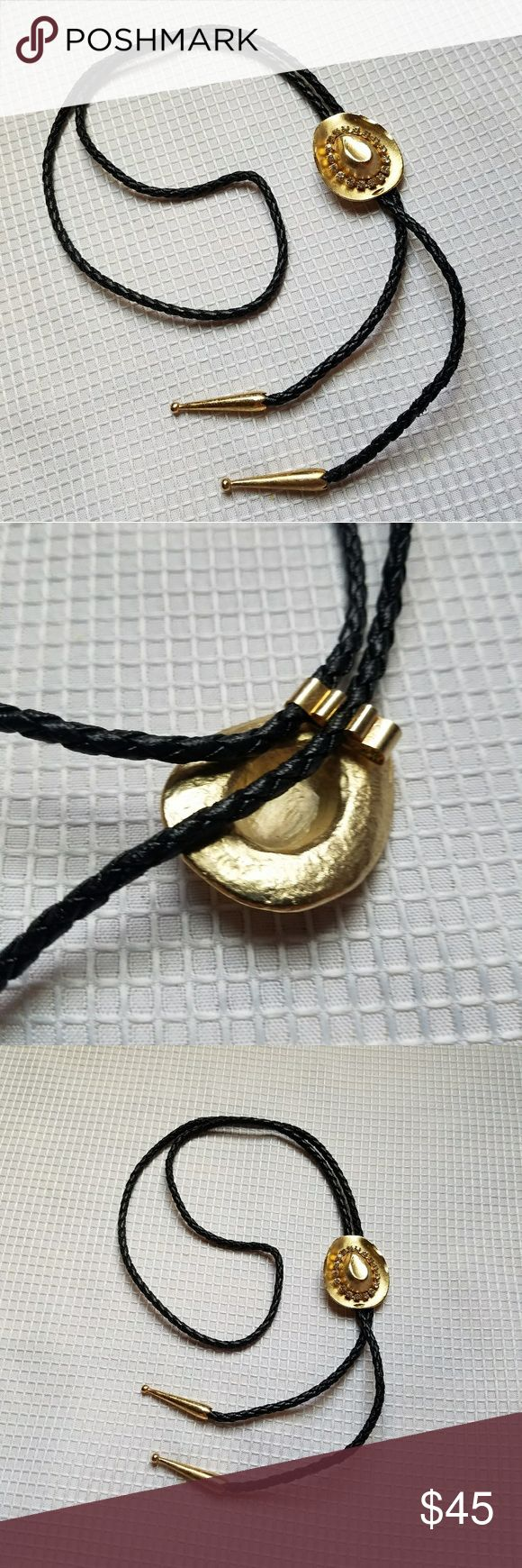 VTG GOLD Rhinestone Bling Cowboy Hat Bolo Tie Rock out with this vintage cowgirl western accessory. Leather-like black braided cording with gold tone hardware and a golden hat with gemstones inside the brim. Has a handmade quality with the etching on the metal. Bought from an estate sale, has a nice weight to it and in great vintage condition with minimal scratching. Metallic southwest southwestern horse riding style rodeo perfect for a collector of hat trinkets shiny Jewelry Necklaces