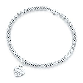 Return to Tiffany™ mini heart tag in sterling silver on a bead bracelet.