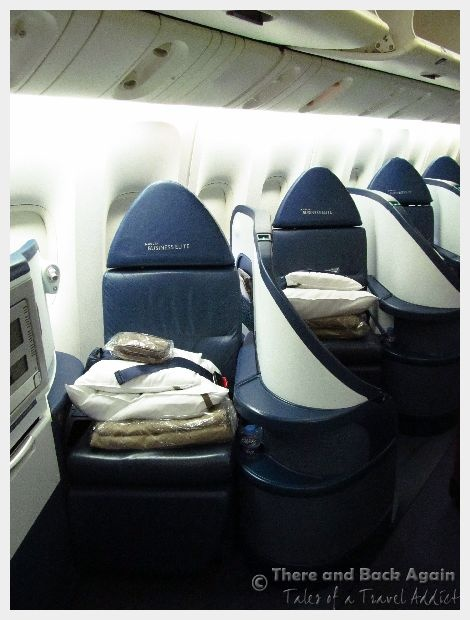 Ever wonder what the difference is between business class vs first class seats on an airplane?  A  description of our first class experience on Delta.