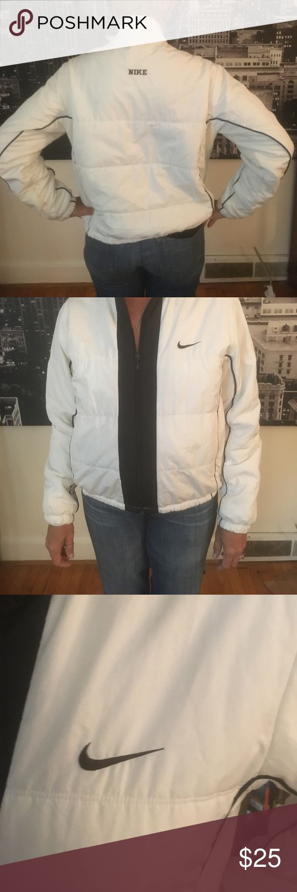 Unisex Nike Retro light jacket Nike lightweight zipped jacket perfect condition worn a few times has pocket on the inside ( great for men or women) Nike Jackets & Coats