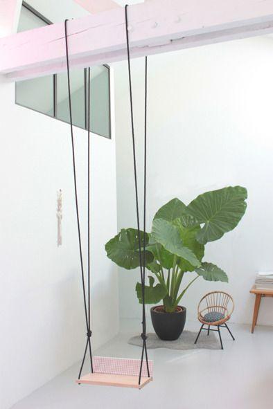 Swing in living room + elephant ear plant
