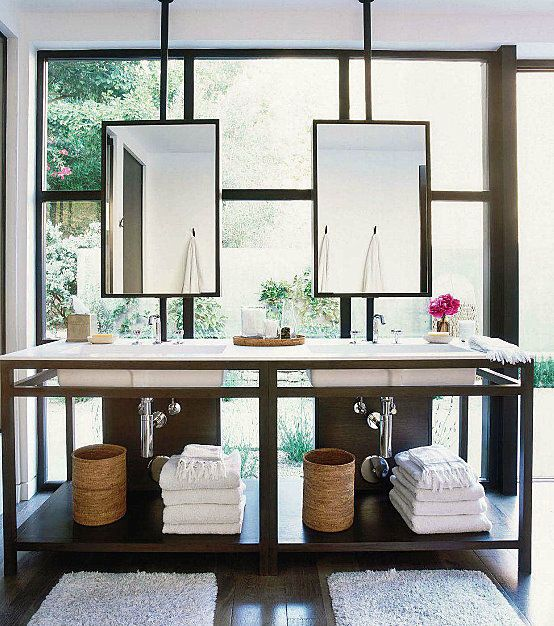 mirrors in front of the windows with open vanity...I love the look...I would kinda still like my privacy though...especially in the bathroom...ahem!