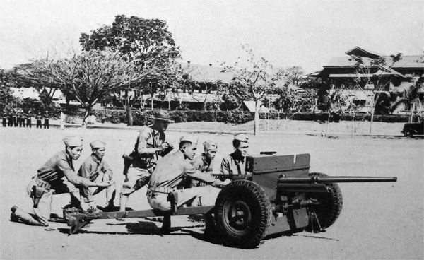 FILIPINO TROOPS training with a 37-mm. antitank gun M3. As a result of the war warning to all overseas garrisons on 27 November 1941, the U.S. forces in the Philippines went on a full war alert. Over a period of years the Japanese had collected a valuable store of information about the Philippines and planned to occupy the Philippine Islands, eliminating all U.S. troops there.