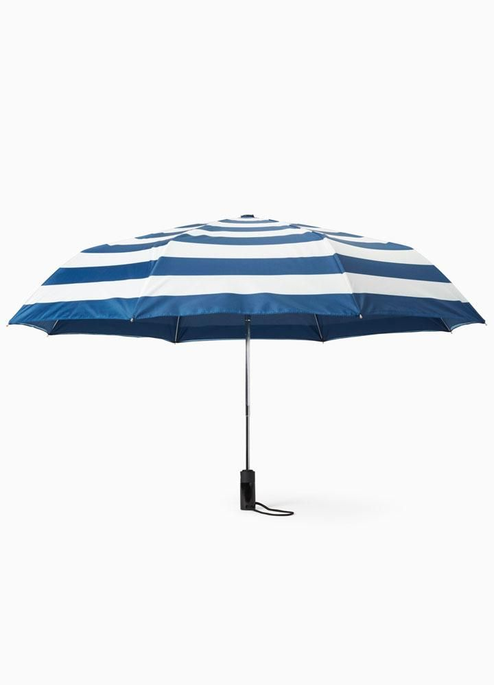 Instantly brighten any gloomy day with Kate Spade's crisp blue and white jubilee stripe travel umbrella. This compact umbrella features an auto open button and comes with a matching pouch.