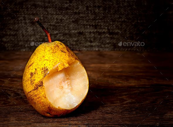 One bitten pear on a wooden table - Stock Photo - Images Download here : https://photodune.net/item/one-bitten-pear-on-a-wooden-table/18751951?s_rank=47&ref=Al-fatih