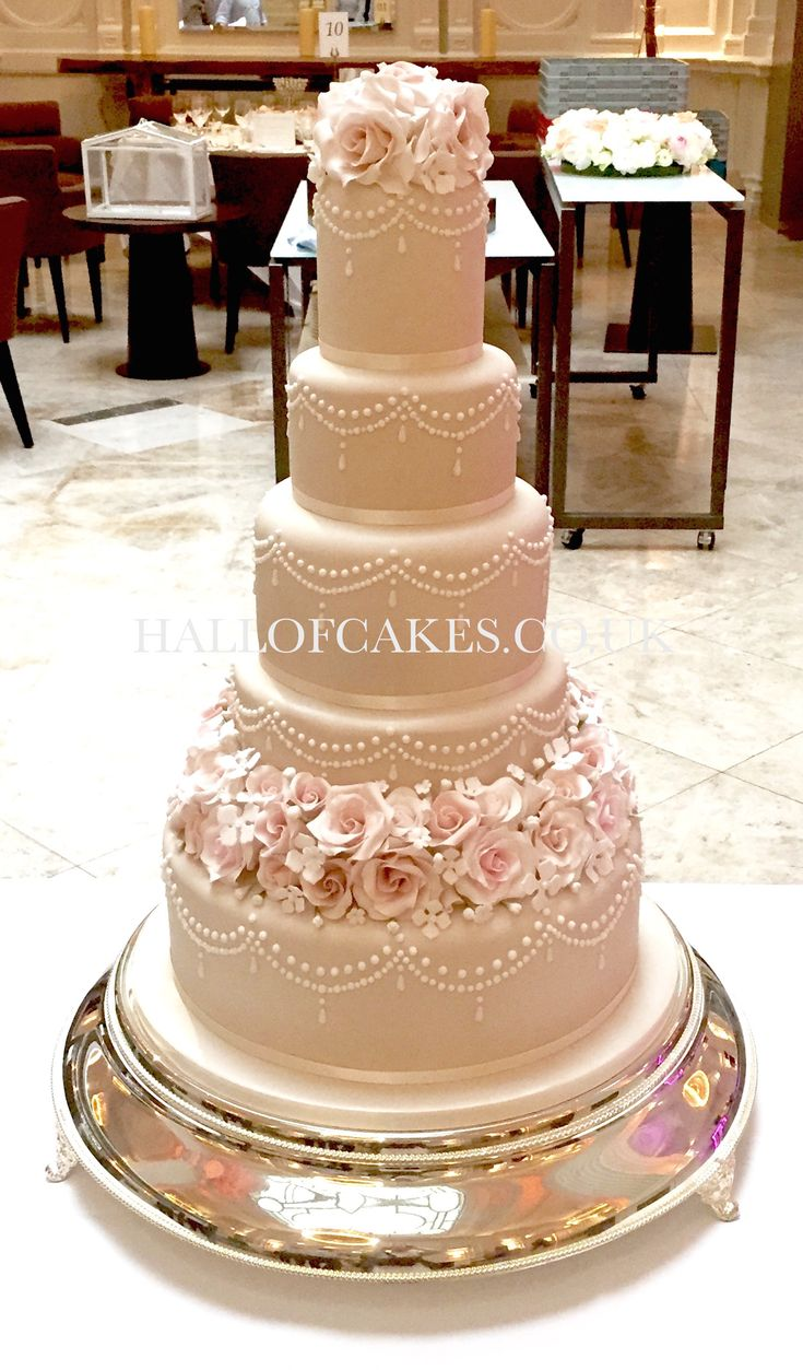 Stunning champagne wedding cake with ornate sugar flowers and blossoms by Hall of Cakes