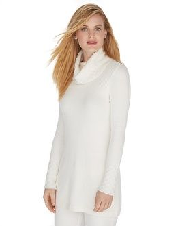 Crystal clear glass beads sprinkle across the high cowl neckline with waving texture on this tunic pullover. Stylist Note: Modestly long tunic pullover is perfect when worn over leggings for the perfect length of coverage.