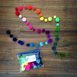 2 metres of pom pom fun ready for you to hang. Super bright rainbow colours -  a mix 41 of  (4cm and 2cm) pom poms strung on black cord. Packaged in a handy zip lock pouch. Not a toy - Please keep out of reach of small children.  http://littleshopof.bigcartel.com/product/rainbow-pom-pom-garland