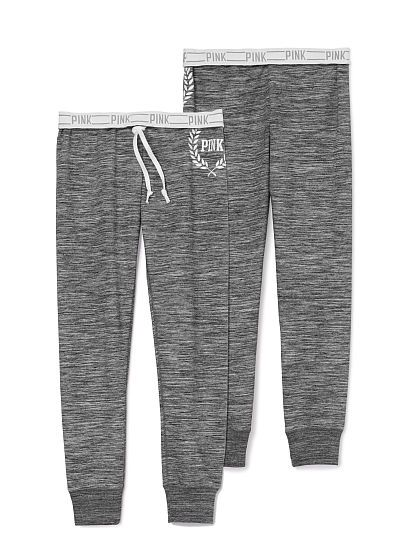 "Gym Pant PINK  Our slimmest pant yet! Extra stretchy with a soft sweatpant feel—meet the gym pant. Perfect for that street sport look. Must-have sweats by Victoria's Secret PINK. JC-326-762 (3YF) Our slimmest fit Exposed logo elastic Banded bottom Cozy, supersoft fleece 29""inseam Imported cotton/polyester"
