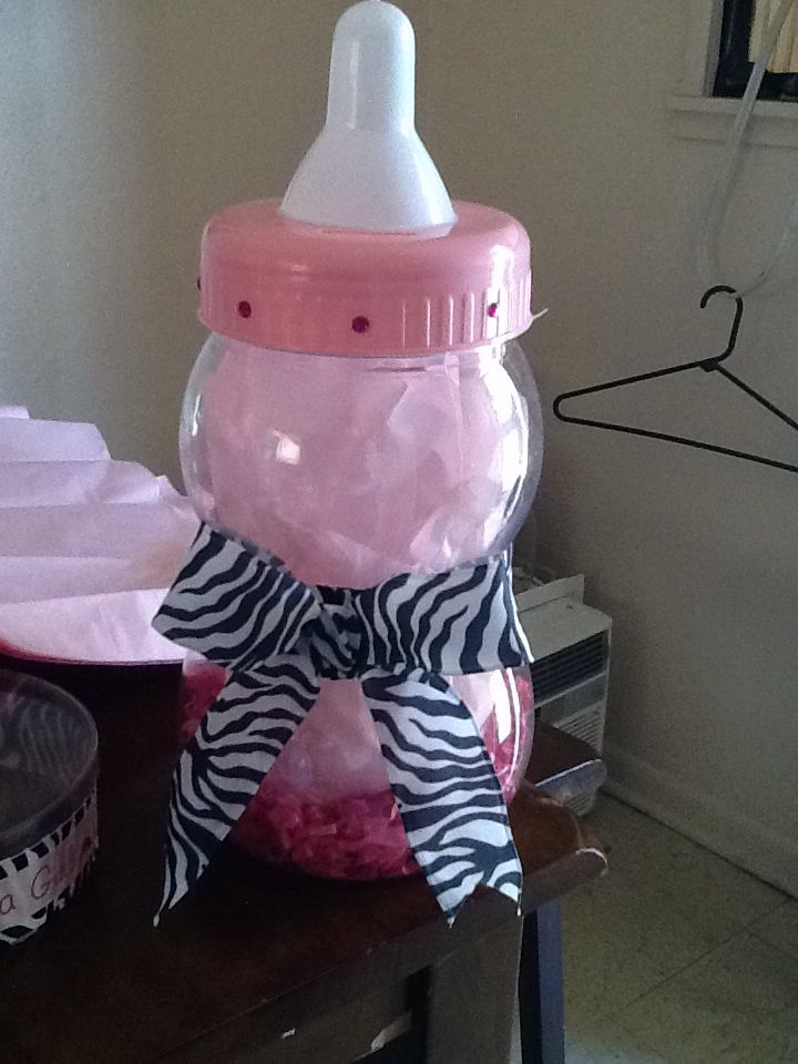 Big baby bottle used as a centerpiece baby shower for Baby bottles for decoration